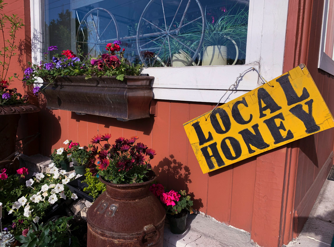 Local Honey Sign hanging on storefront